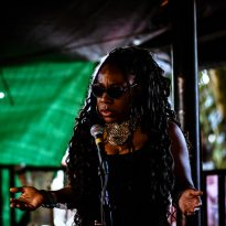 BEAT POET TENESHA THE WORDSMITH DECONSTRUCTS THE LAYERS OF ANGLO-AMERICAN RACISM WITH DEFIANT AUTHORITY